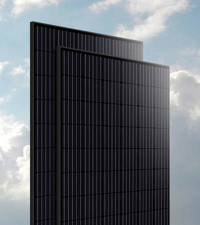 isolated black solar panels against blue cloud sky