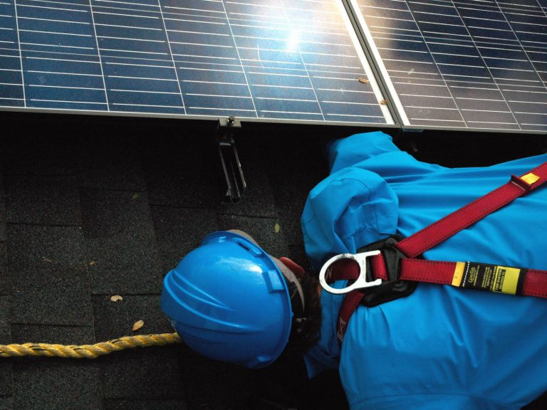 solar panels being installed by engineer
