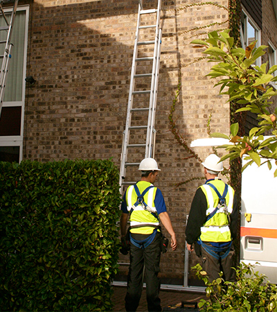surveyors inspect a home before installation