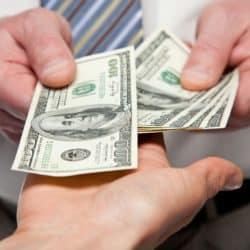 image of hands exchanging money