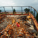 Labourers clear debris and rubble on the top floor of what was once a hotel which was destroyed by the Nepal earthquake in the Nagarkot hill station village anciently known as Mandapgiri in the Bhaktapur District, Nepal.