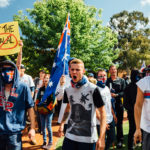 Supporters of the Reclaim Australia group shout and hold banners during a protest organised by the far right wing group. Melbourne, Australia November 22 2015.