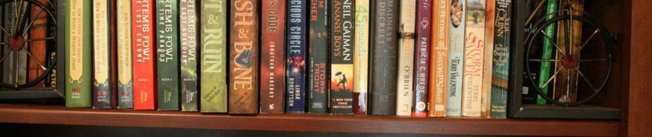 Three shelves of a jam-packed bookshelf