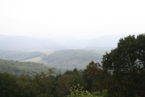 A mountain view into the valley, with mist