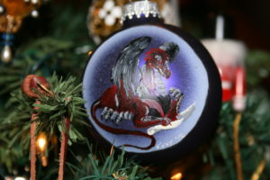 a painted glass ornament, a dragon, writing