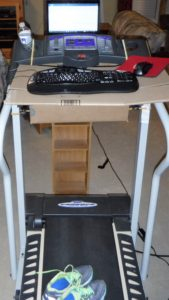 treadmill with boxes bungie corded to make a platform for keyboard. Computer on a DVD holder.
