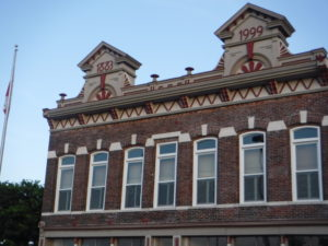 red brick building with arched windows