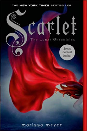 A red cape, blowing backwards, with the hint of red hair of the girl it belongs to