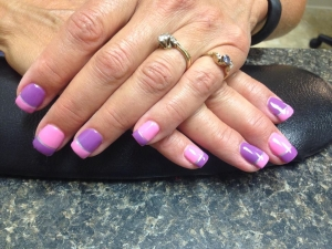 A manicure in purple and pink at The Ritzz Salon