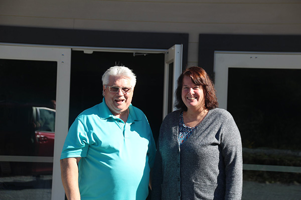 Pastor Norm and Pastor Tammy outside Mill Bay Church