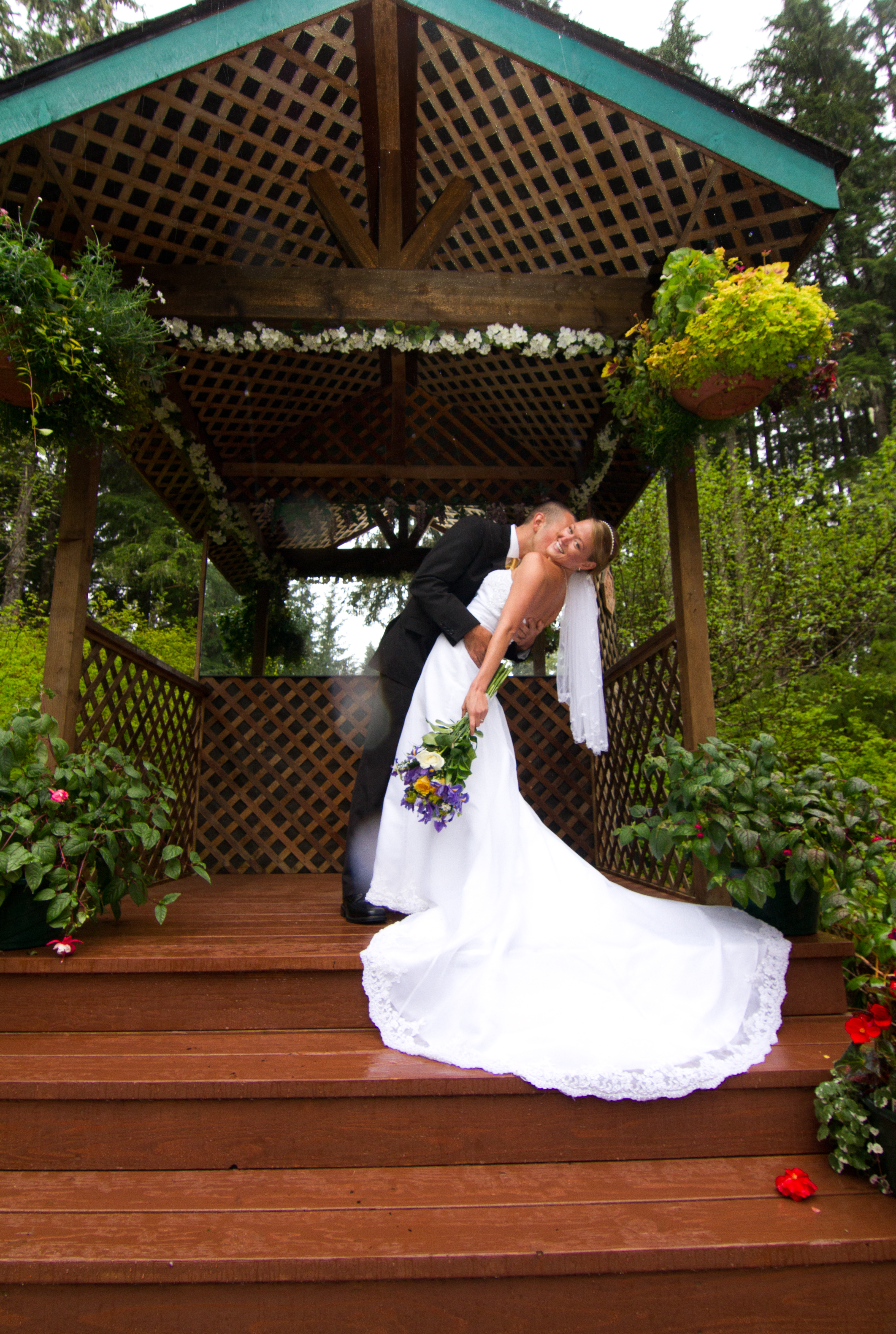 Photo of the first kiss at a wedding in the rain forest garden at Pearson's Pond Luxury Inn and Adventure Spa.