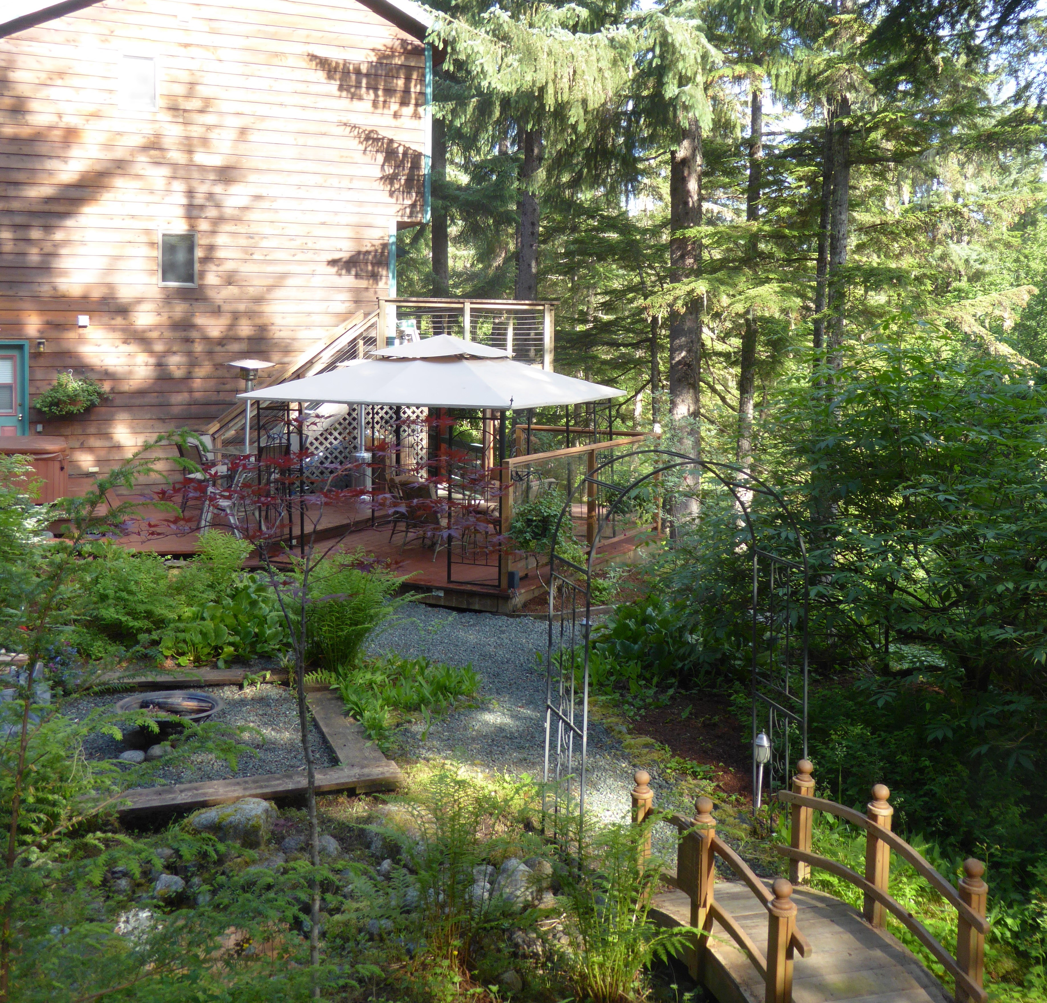Photo of the lower gazebo from the top of the waterfall at Pearson's Pond Luxury Inn and Adventure Spa in Juneau, Alaska
