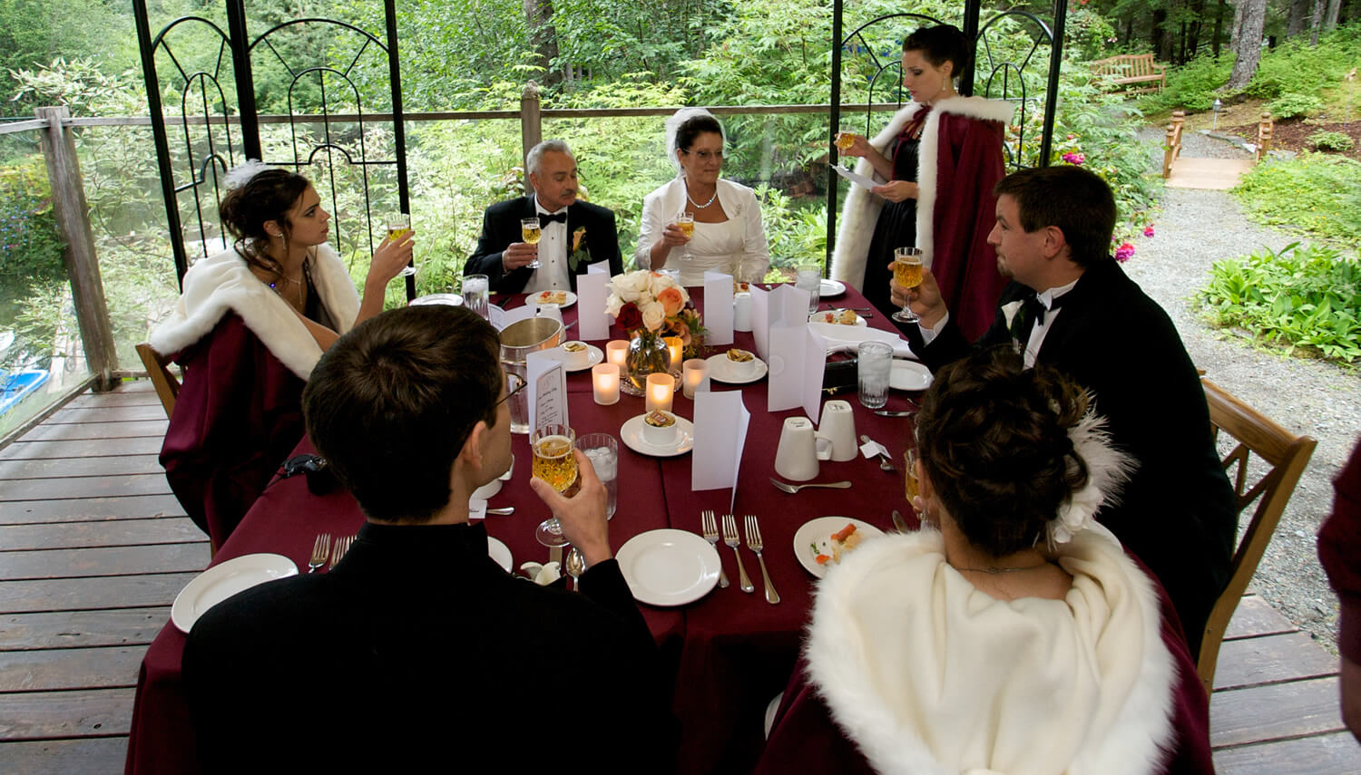 Catered reception dinner for wedding party in the garden gazebo at The Pond