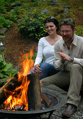 Photo of honeymoon couple enjoying the fire pit at Pearson's Pond Luxury Inn and Adventure Spa.
