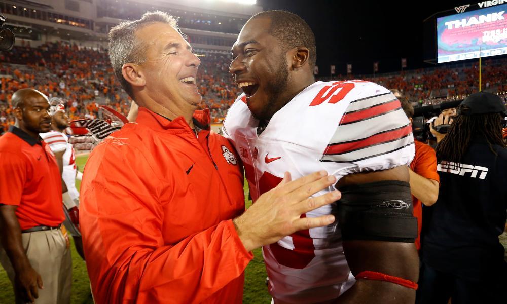 Ohio State Buckeyes head coach Urban Meyer hugs Buckeyes defensive lineman Tyquan Lewis last September.