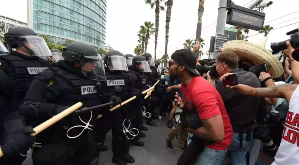 'Racists!' 'Illegals!' 'Scum!' protesters v Donald Trump supporters