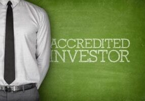 Accredited,Investor,Text,On,Blackboard,With,Businessman,On,Side