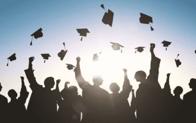 Photo of graduates tossing caps.