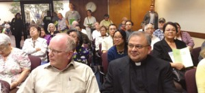 All Souls pastor Fr. Agnel De Heredia, right, and parish school principal Vincent Riener, left, attended a planning commission meeting May 2 to speak against a proposal by Planned Parenthood to open a clinic on the city's main commercial stree