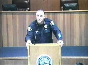 Police Chief Jeff Azzopardi address the standing room only audience