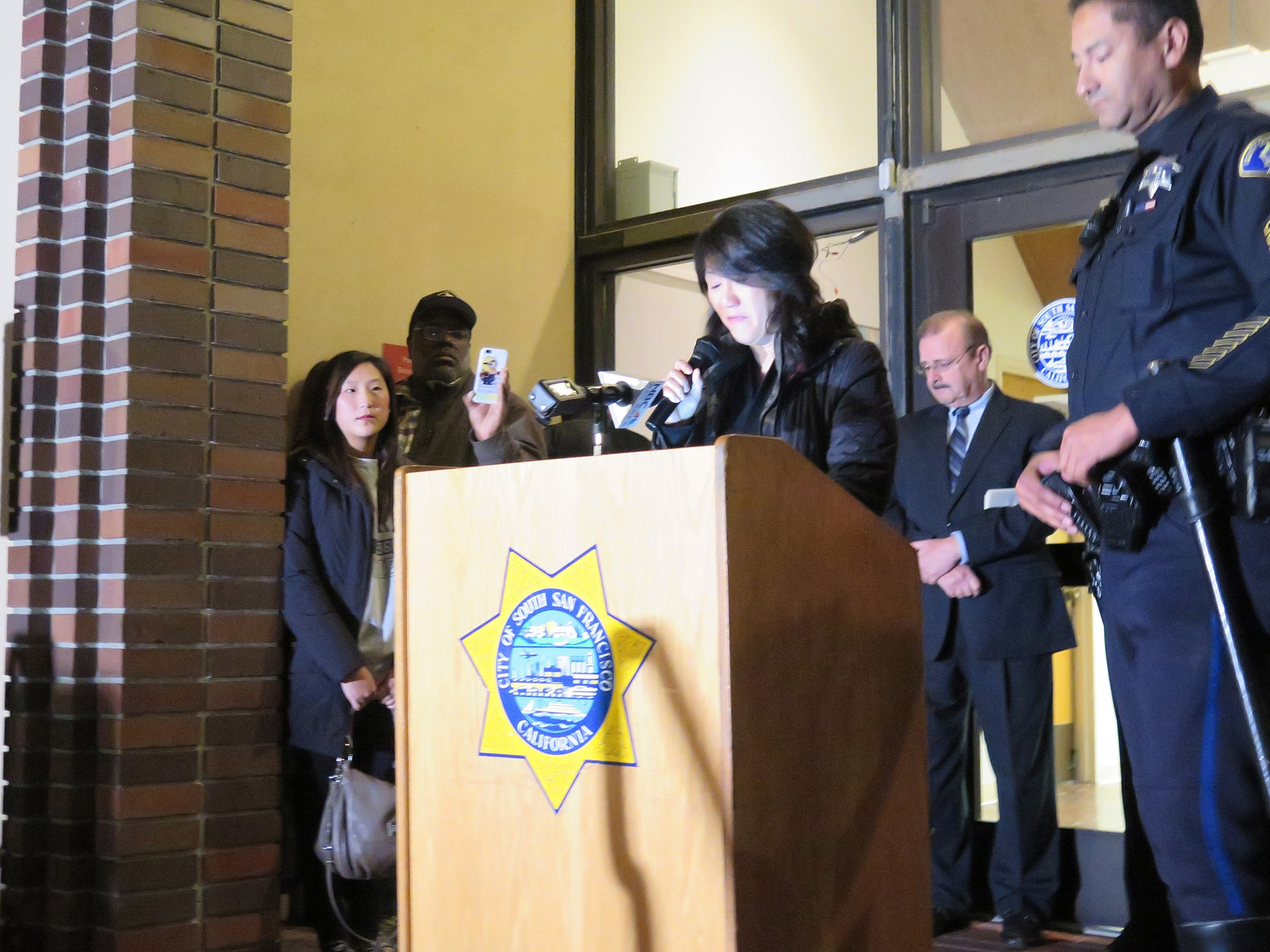 """Yumi Chon, Officer Chon's sister, thanked the crowd for their support. """"I beg you to please, please continue to pray for his recovery"""" Photo: SSFPD"""