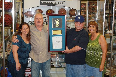 The Bono family won a Jackie Robinson authenticated autograph piece this year at South Bay Baseball Cards.