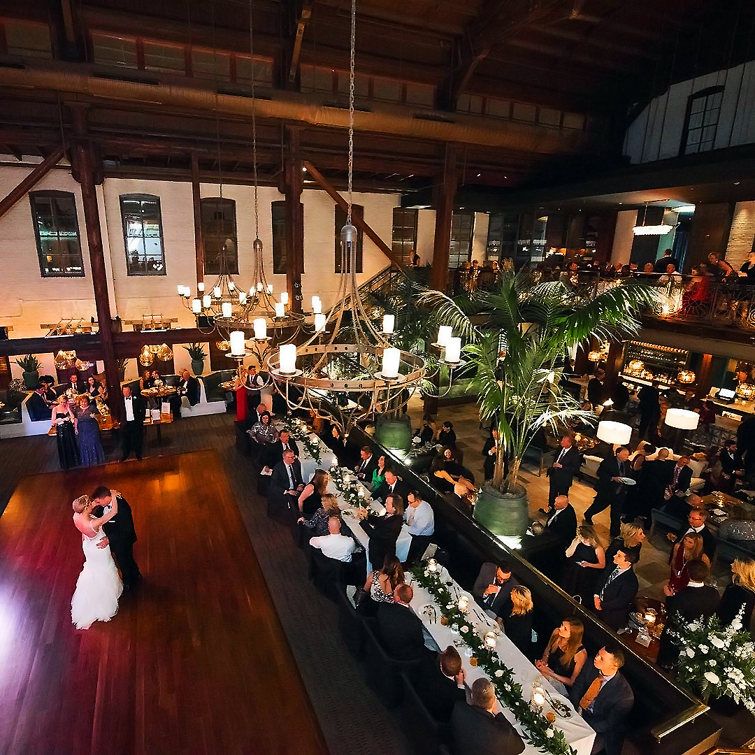 Bride and groom dancing alone on dance floor during wedding reception at Bar Vasquez