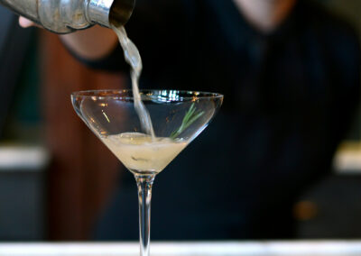bartender-pouring-martini-craft-cocktail-during-happy-hour-at-bar-vasquez