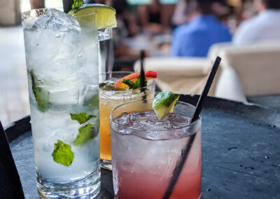 mixed-drinks-and-craft-cocktails-on-tray-during-happy-hour