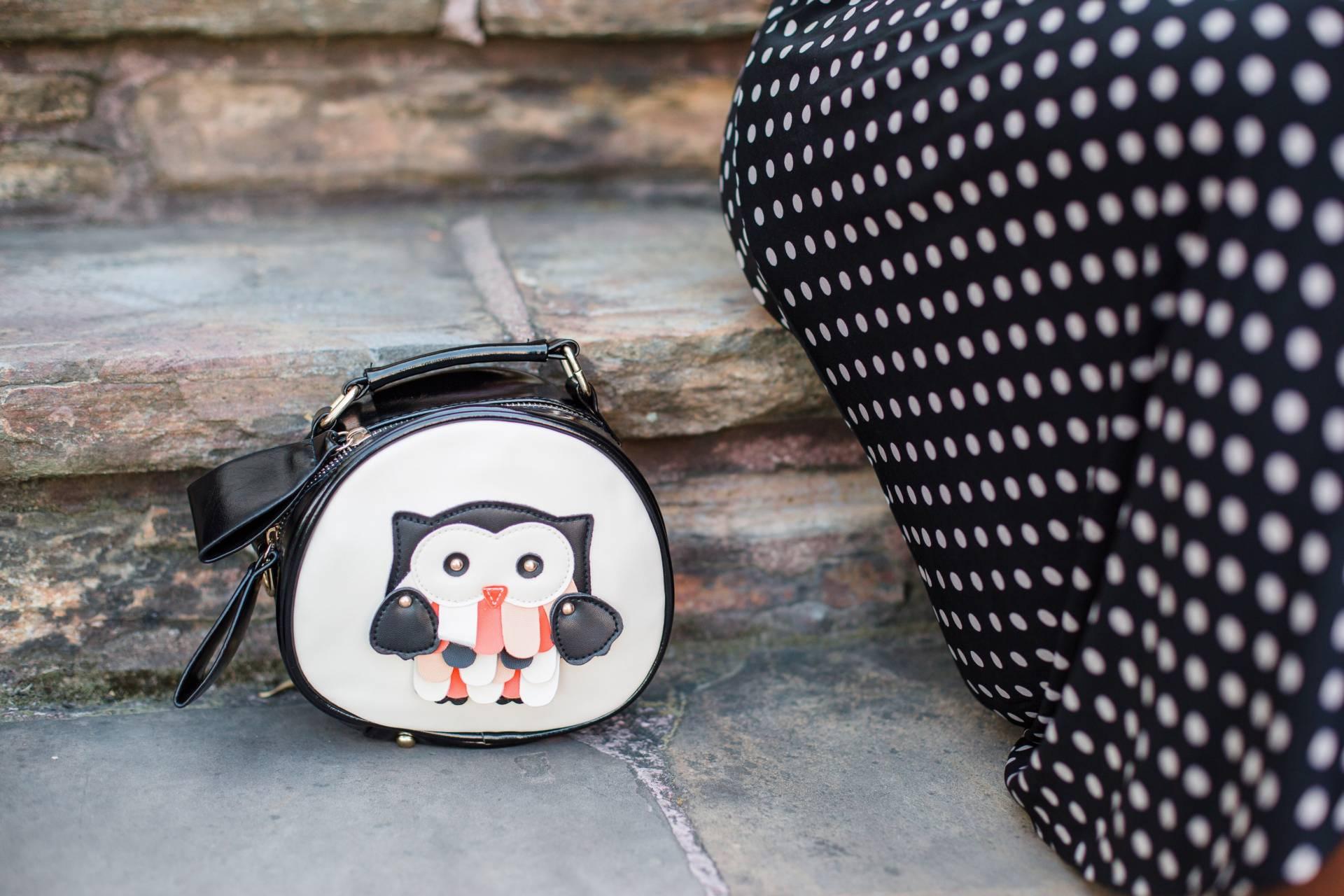 polka-dot-dress- statement bag