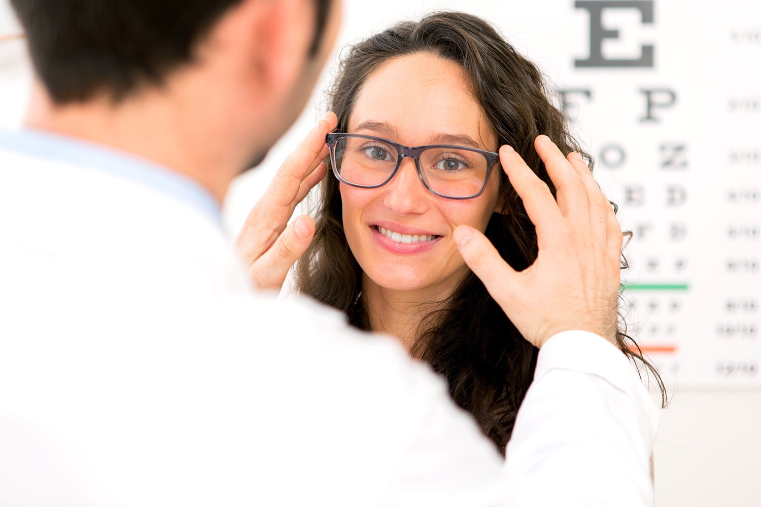 A  woman who is getting eye exams with an optometrist in Scarborough.