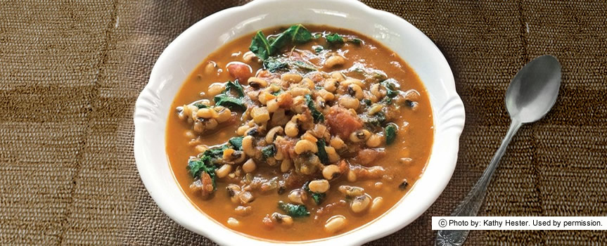 A bowl of Smoky Sweet Black Eyed Peas and Greens.