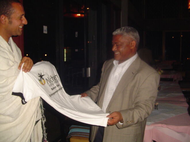 Presenting an NGO tshirt to the Governor