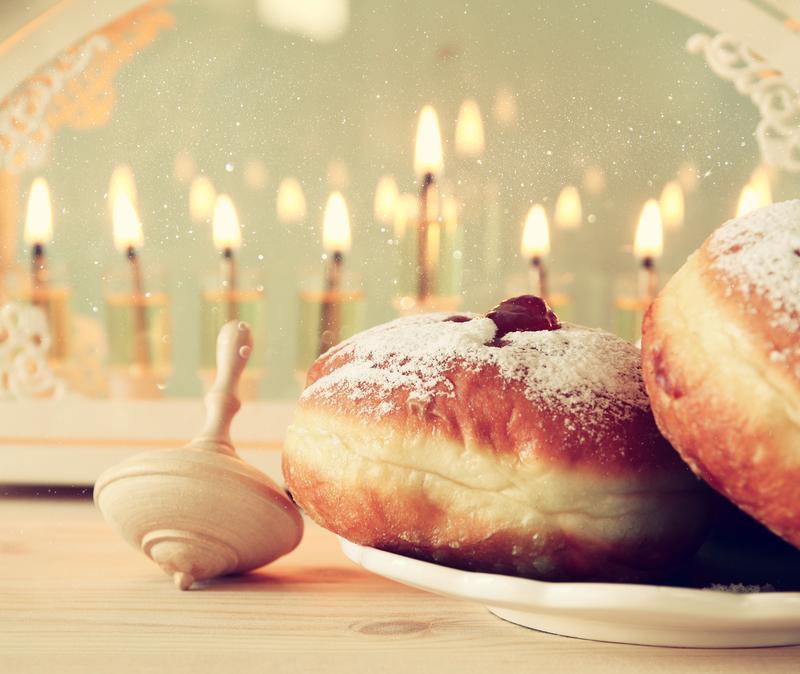 Menora, dreidl, donuts, three symbols of Chanuka