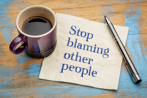 Meme: Stop blaming other people, on lined paper with coffee mug and pen