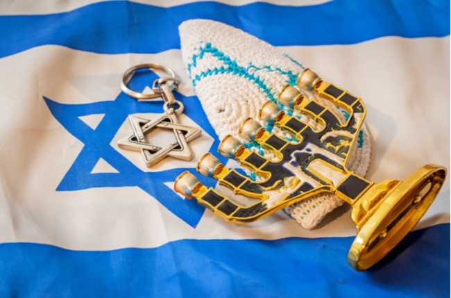 Israeli flag juxtaposed with Jewish items to illustrate that Israel is the Jewish State