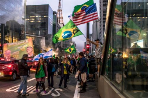 Brazilian Bolsonaro supporters celebrate with Brazilian, US, and Israeli flags
