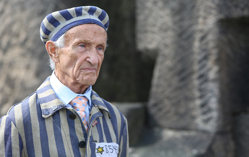 Ed Mosberg, concentration camp survivor wearing camp inmate uniform