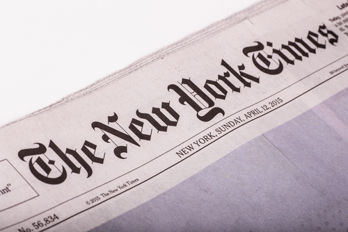 New York Times logo on newspaper cover