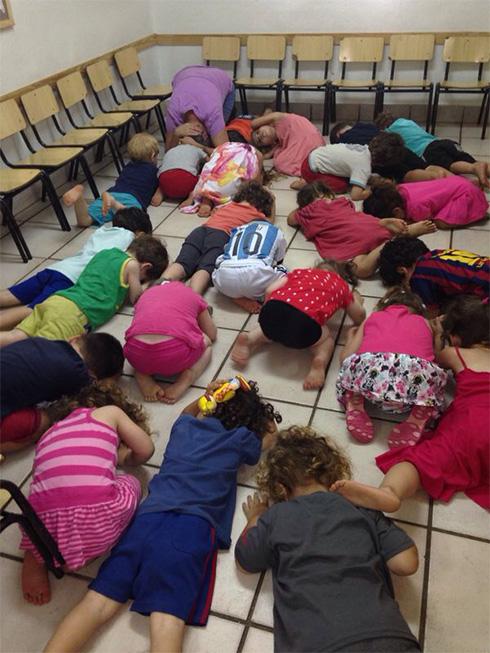 Children hunker down in Israeli kindergarten during Operation Protective Edge in Israel