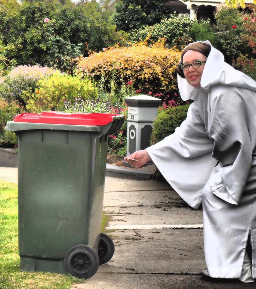 woman dressed as Princess Leia, takes out trash during COVID-19