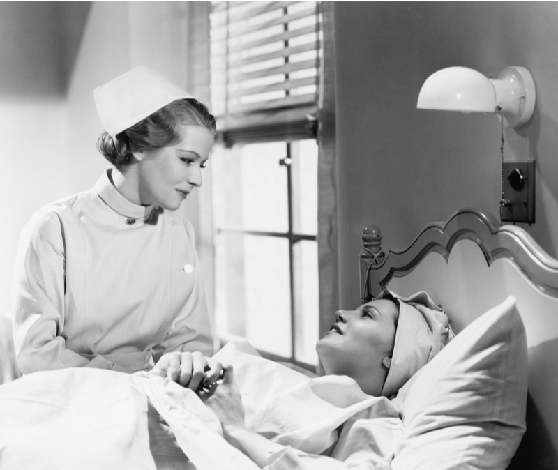 old fashioned nurse comforts patient