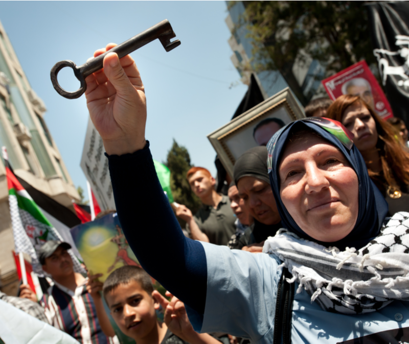 arab woman with key at protest