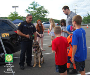 BA12_0318policek9withchildren