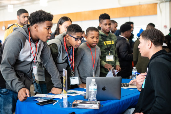 Middle and high school-aged students learn about coding and career pathways