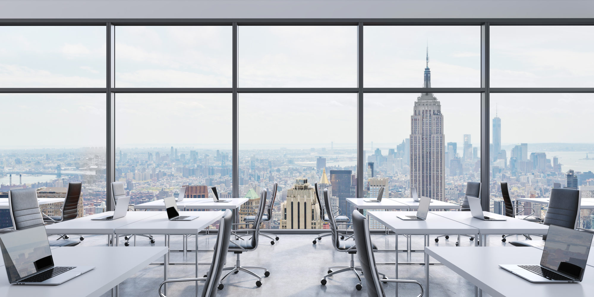 Workplaces in a modern panoramic office, New York city view from the windows. Open space. White tables and black leather chairs. A concept of financial consulting services. 3D rendering.