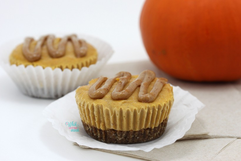 """Mini Pumpkin Spice Latte """"Cheesecakes"""" with protein crust and almond butter maple """"caramel"""" drizzle"""