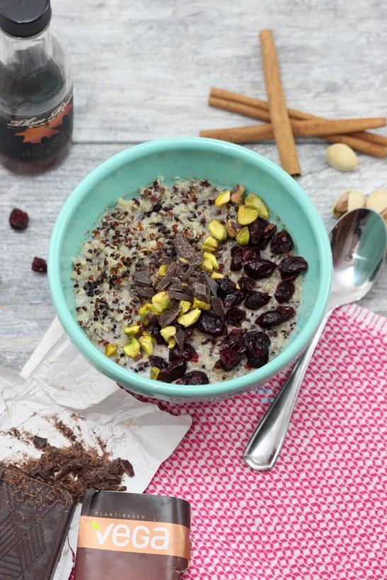 Cranberry Pistachio Quinoa Breakfast Bowl with chopped Maca Chocolate