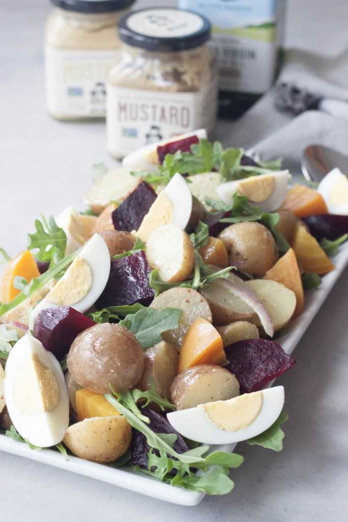 Roasted Beet Potato Salad isn't your granny's potato salad, this colorful salad has spunk, added nutrition, and it's own beet. A Whisk and Two Wands