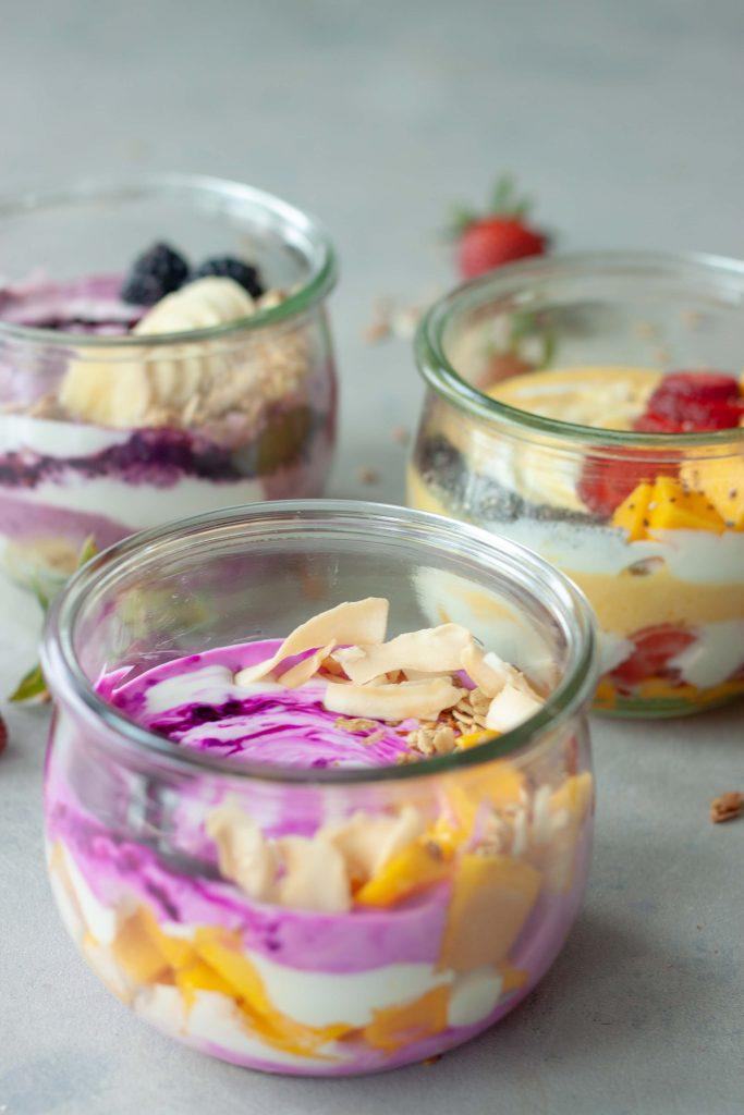 3 yogurt bowls, mango, strawberries, blackberries, pitaya, mango, granola, bananas, chia